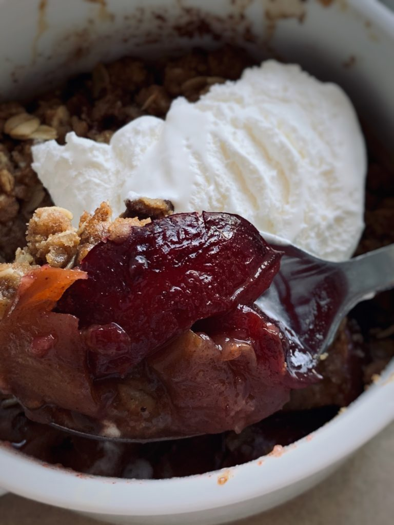 apple and plum crisp with whipped topping