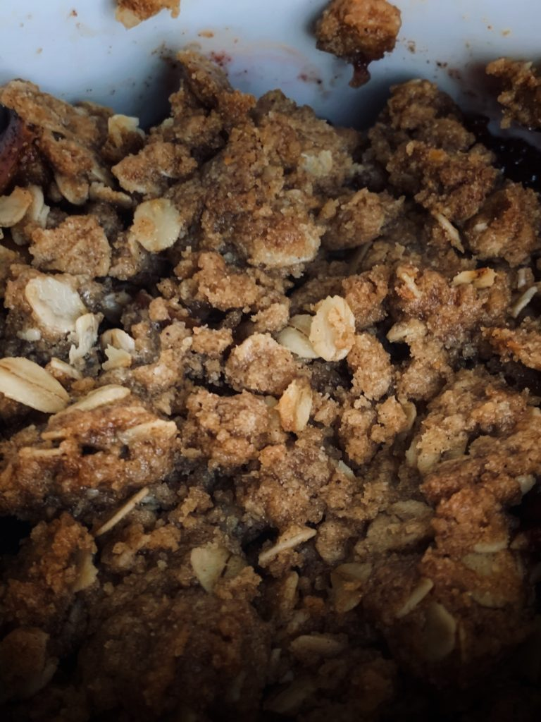 close up photo of apple and plum crisp topping