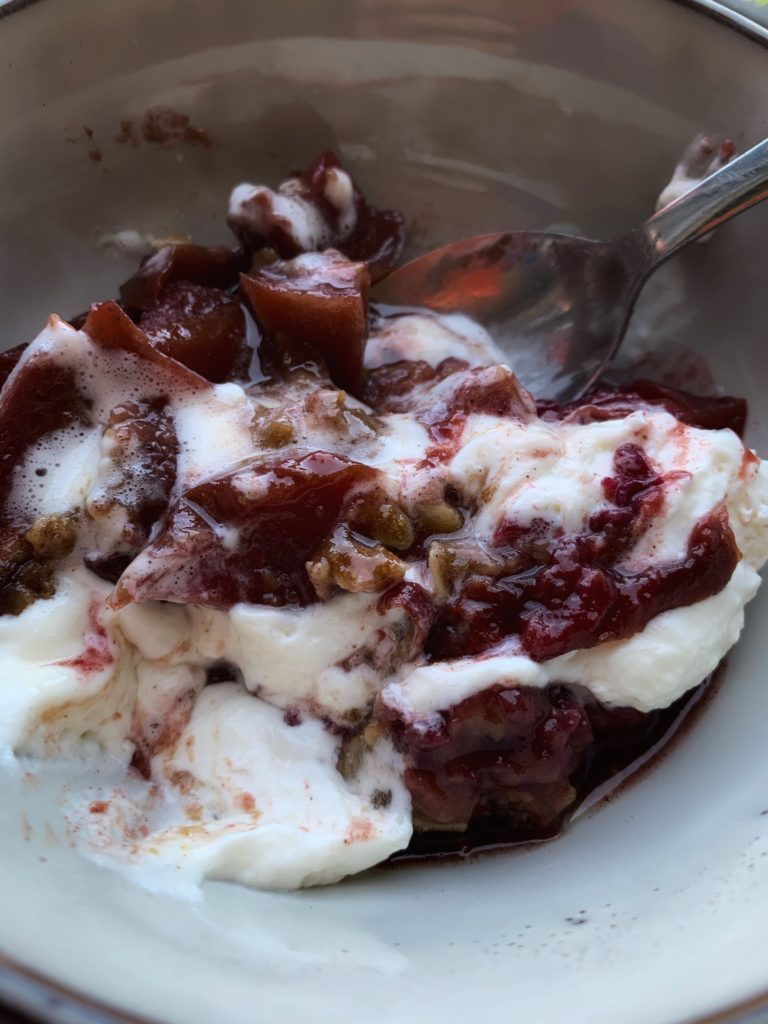 apple and plum crisp mixed with whipped topping