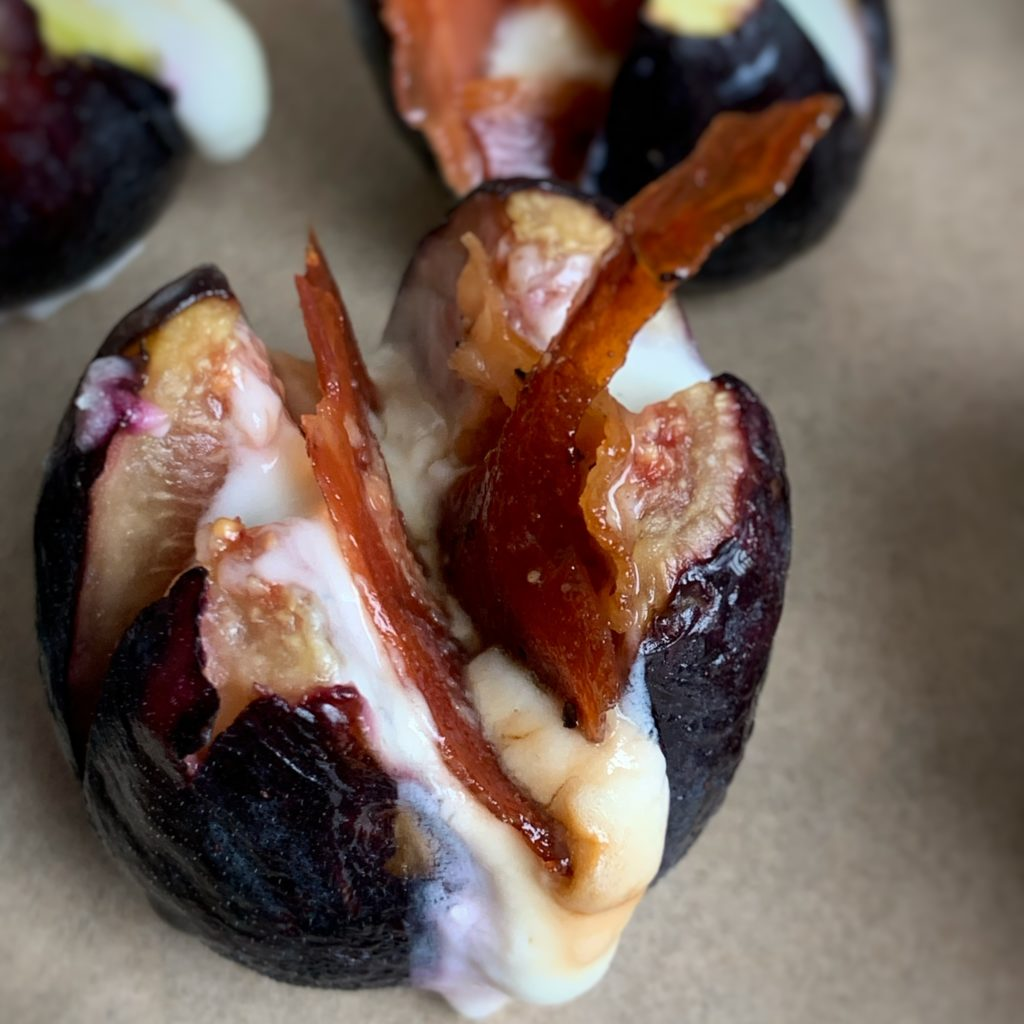 close up of cheese filled fig